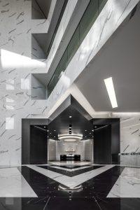 Architecture Building Repositioning Corporate Interior Design 1415 Louisiana Houston Circular Lighting Entrance Lobby Black and White