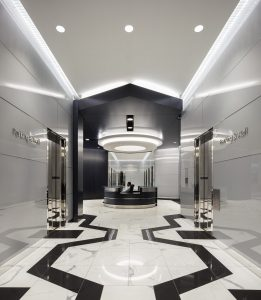 Architecture Building Repositioning Corporate Interior Design 1415 Louisiana Houston Circular Lighting Entrance Lobby Black and White Geometric Floors