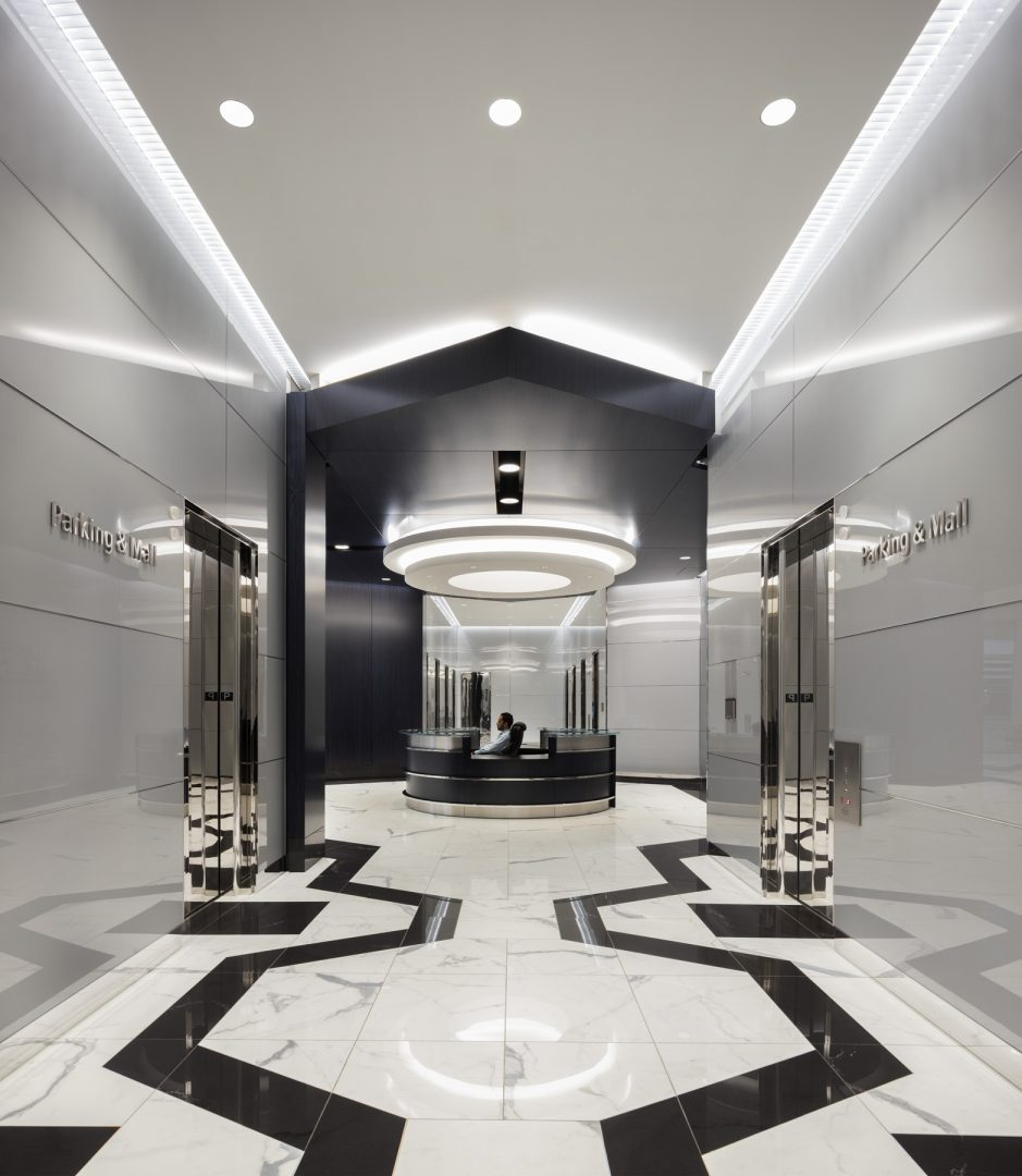 Architecture Building Repositioning Corporate Interior Design 1415 Louisiana Houston Circular Lighting Entrance Lobby Black and White Geometric Floors