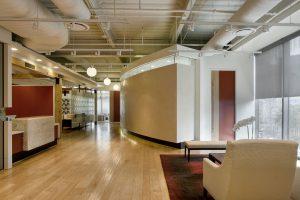 Non-Profit Corporate Interior Design Houston Curved Corridor Walls Venetian Plaster White and Red