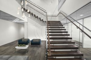 NEWFIELD EXPLORATION Corporate Interior Design Staircase Wood Glass Balustrade
