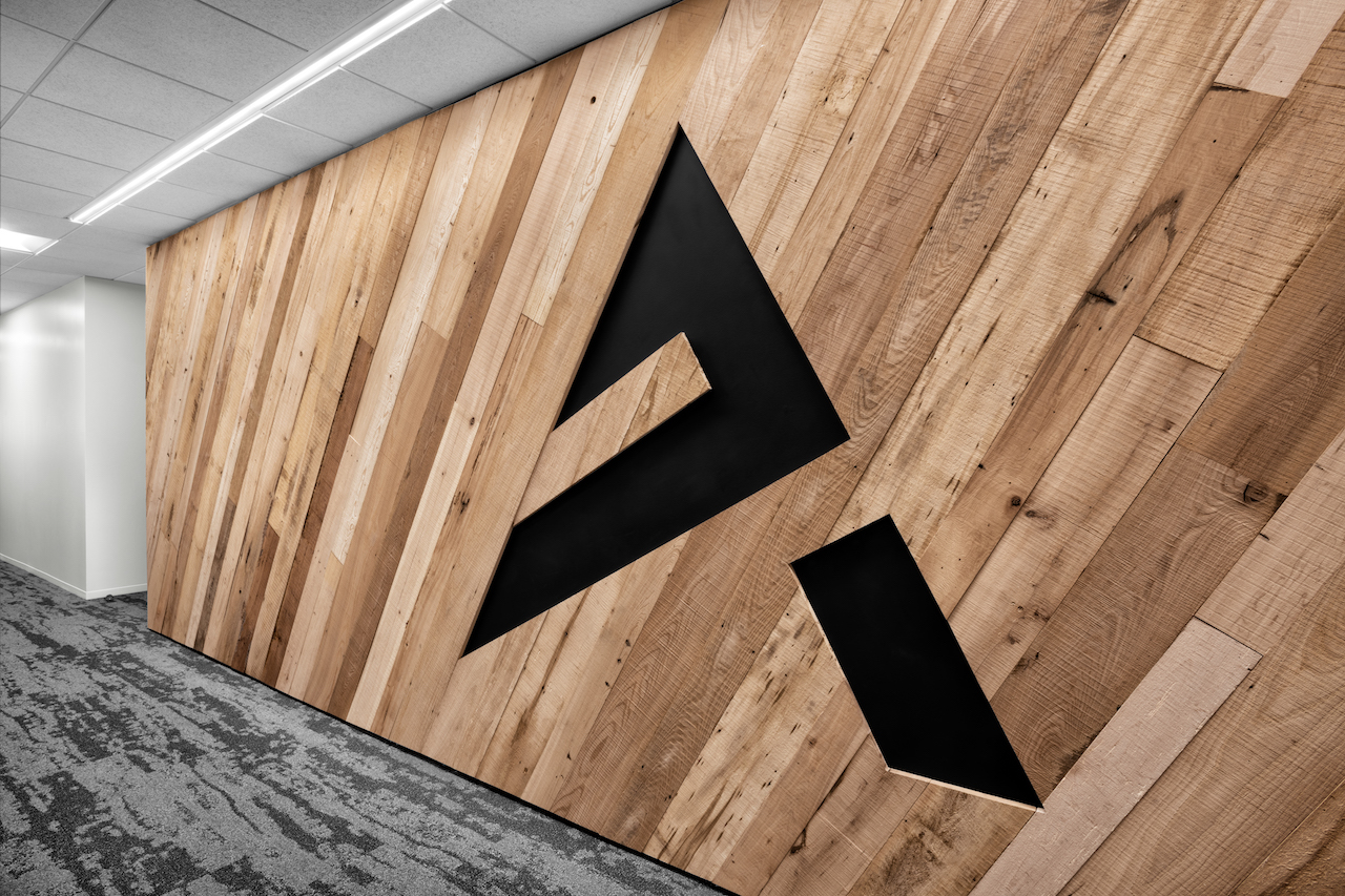 Corporate Interior Design Aptim The Woodlands BNatural Wood Panelling Company Logo