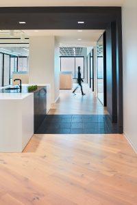 Corporate Interior Design Nova Chemicals Houston Breakroom Island Black and White Corridor