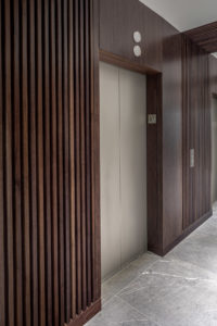 HighPoint Resources Corporate Interior Design Elevator Lobby Wood Wall Floor Tile