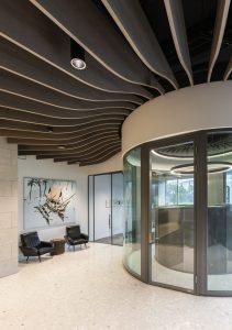 Corporate Interior Design Lobby for Dynamis Power Solutions Turibine Wood Slat Ceiling Entrance Lobby
