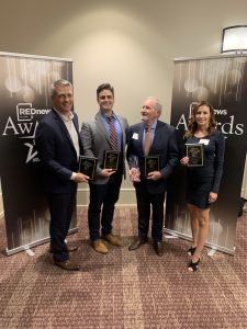Abel Design Group Accepts REDNews 2020 Award