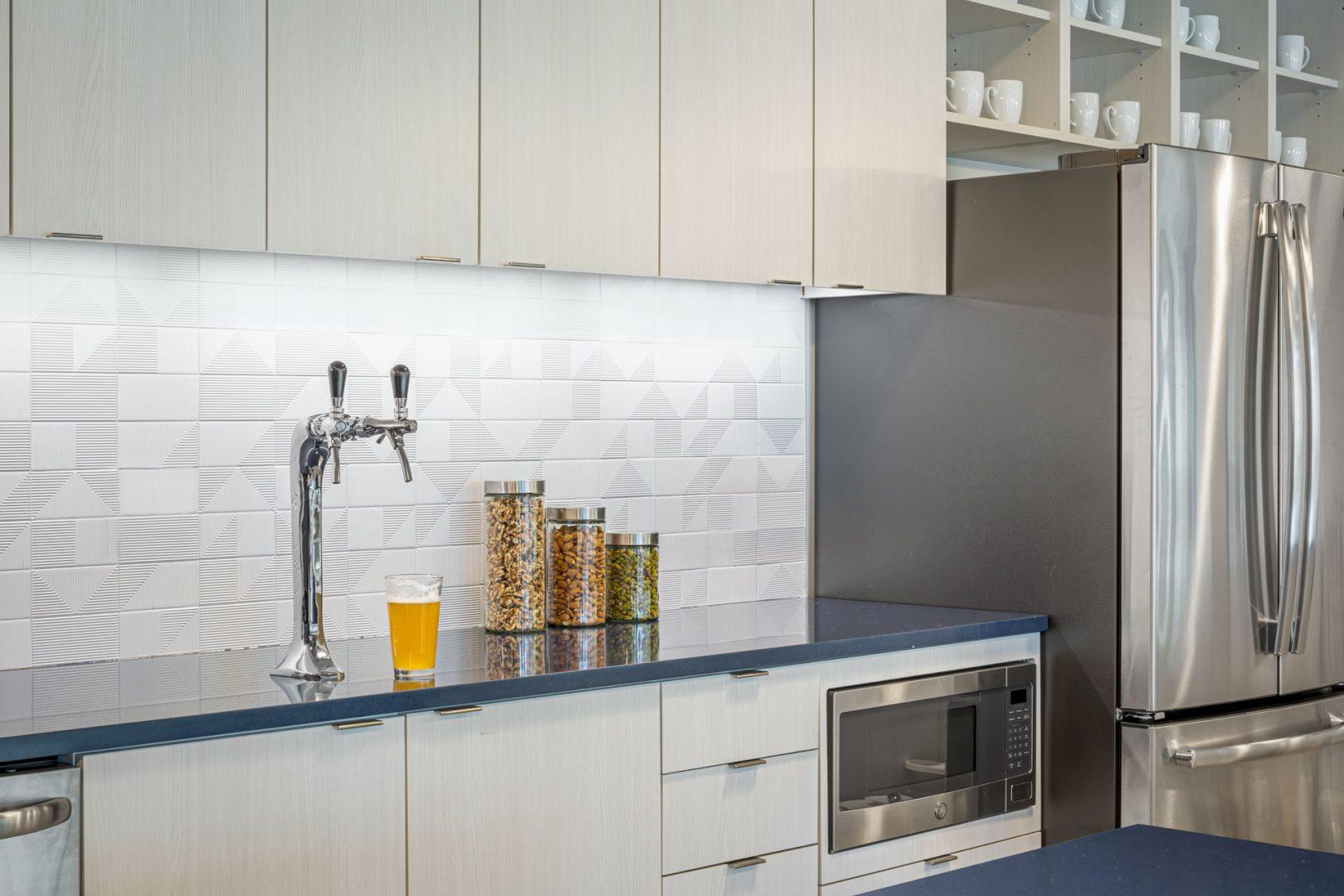 Corporate Interior Design Breakroom Navy Countertop White Textured Subway Tile Cognizant Denver