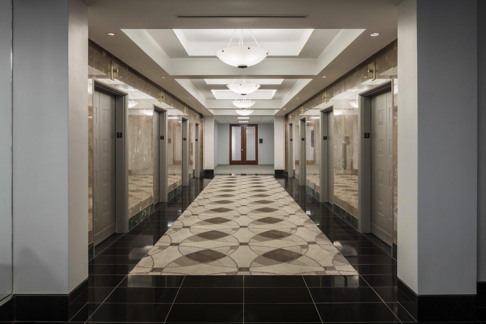 Architecture Building Repositioning Corporate Interior Design 1001 McKinney Houston Elevator Lobby Historical Preservation