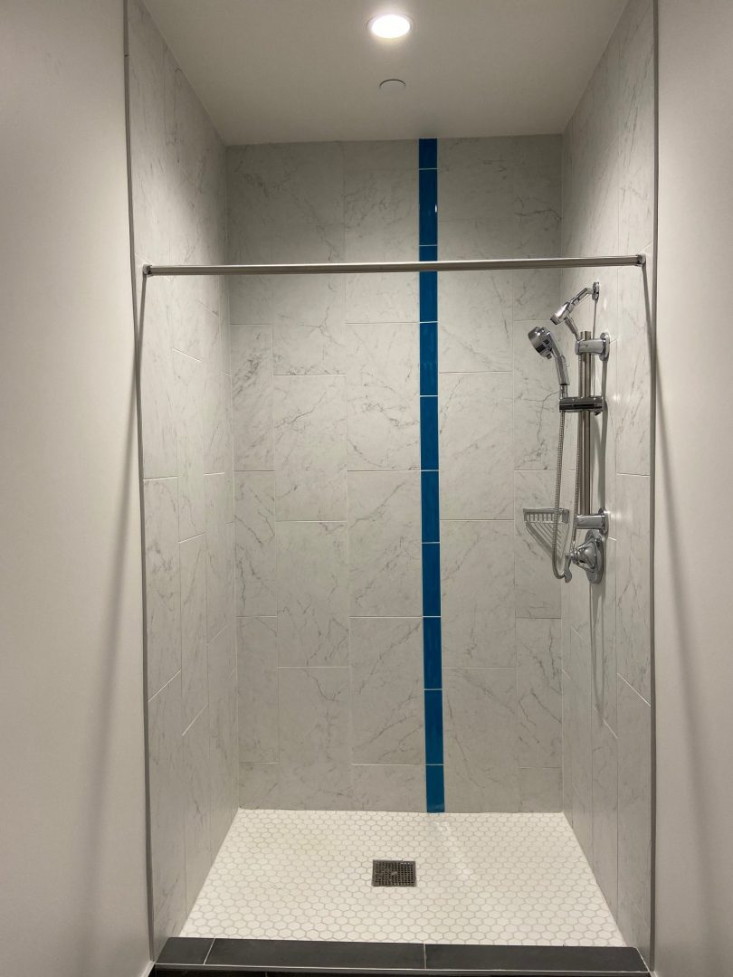 Houston Architecture Building Repositioning 1415 LOUISIANA FITNESS CENTER Houston Corporate Interior Design Shower