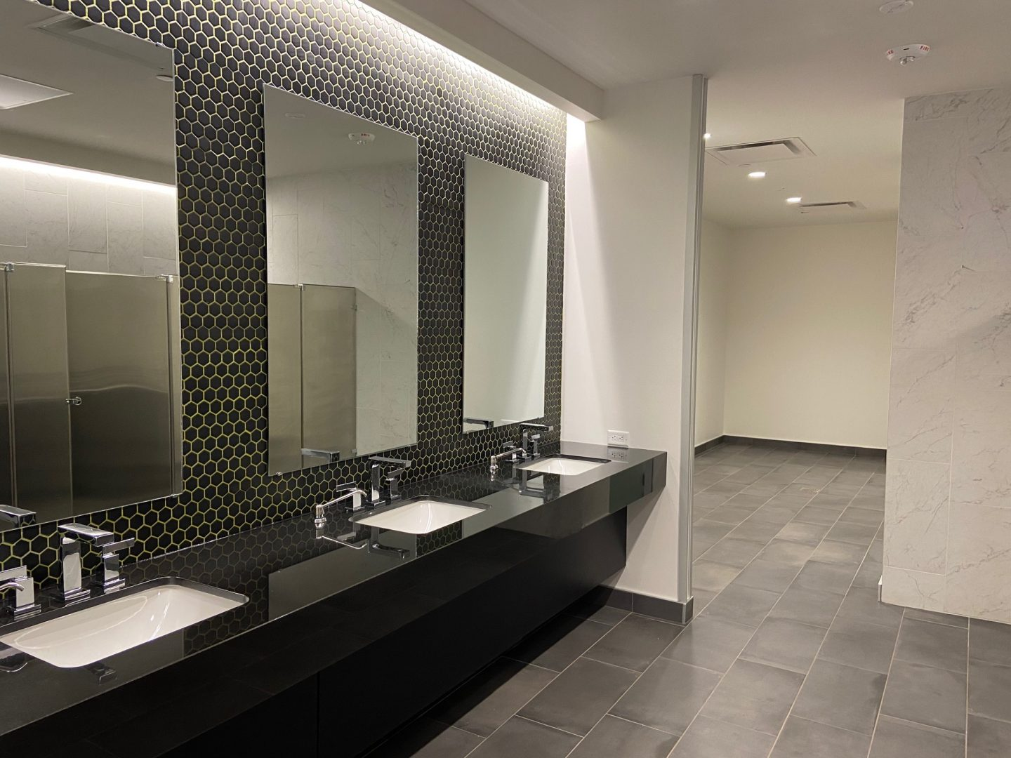Houston Architecture Building Repositioning 1415 LOUISIANA FITNESS CENTER Houston Corporate Interior Design Locker Room Restroom