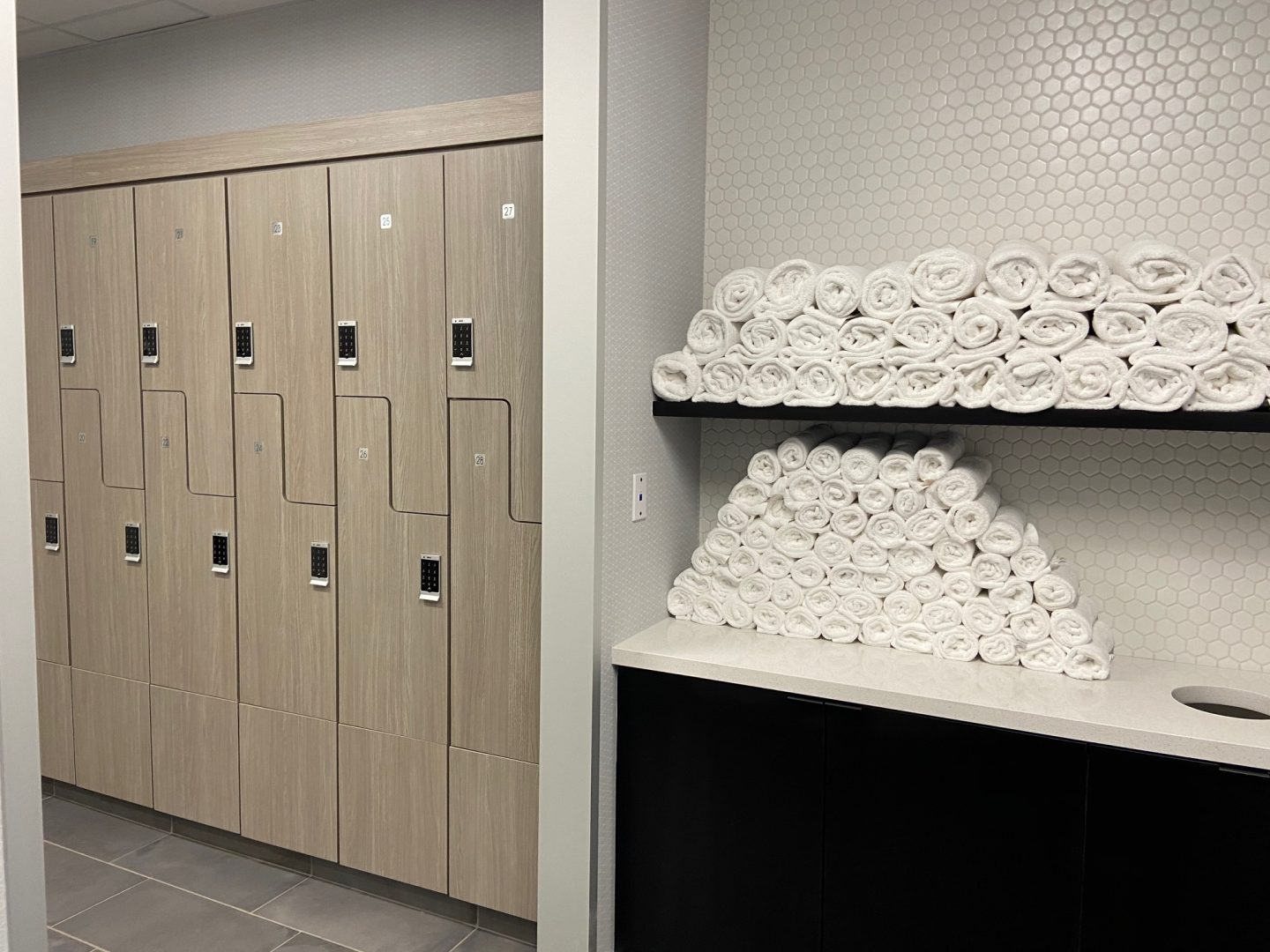 Houston Architecture Building Repositioning 1415 LOUISIANA FITNESS CENTER Houston Corporate Interior Design Locker Room Towels Storage