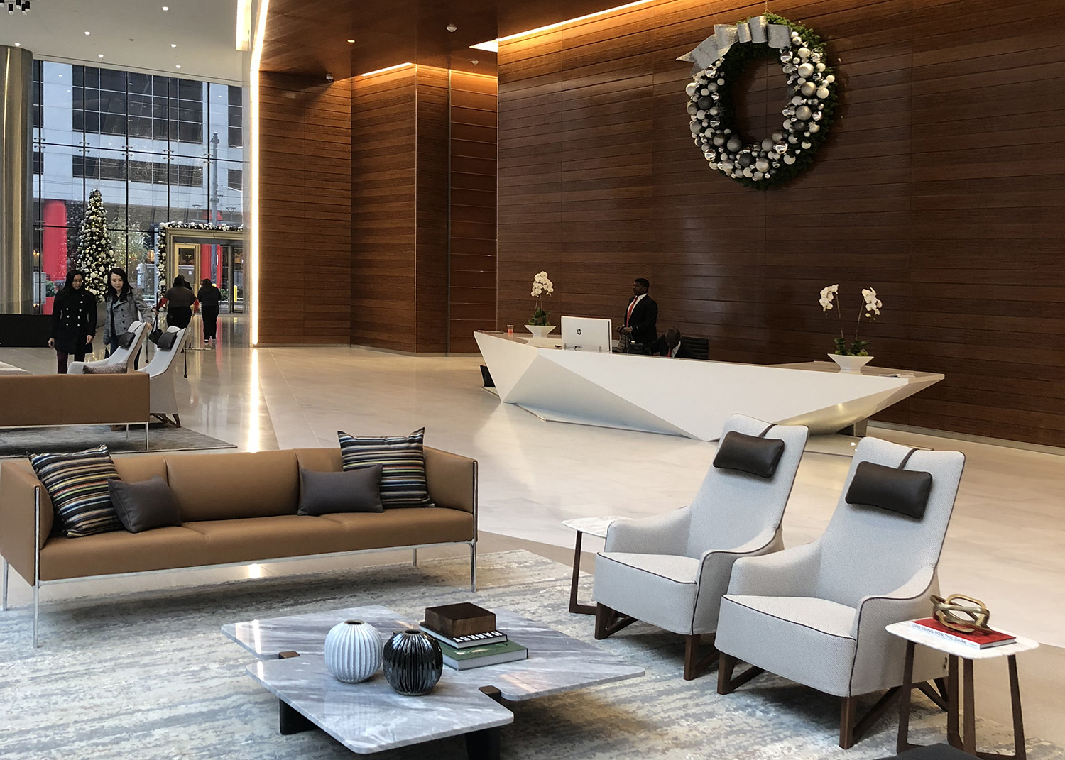 Building Repositioning Lobby Renovation 609 Main St Houston Lobby Seating Wood Wall Warm Neutrals