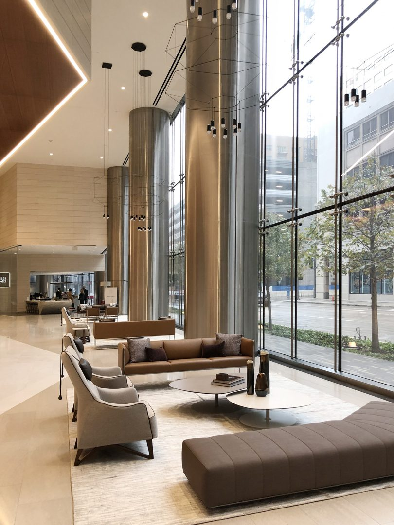 Building Repositioning Lobby Renovation 609 Main St Houston Lobby Seating Area Chandelier Warm Neutrals