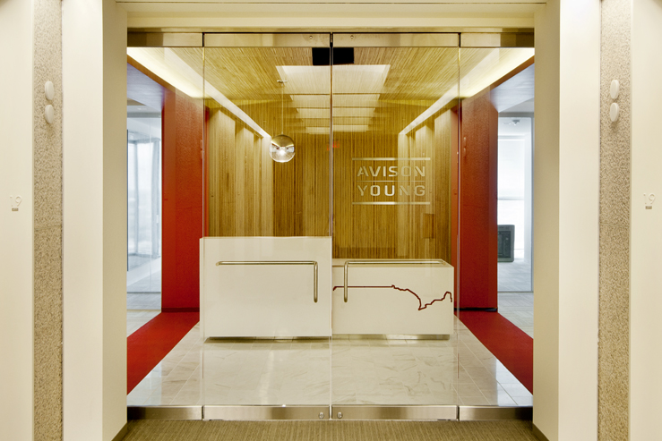 Corporate Interior Design Houston Avison Young Entrance Lobby Canadian Border Reception Desk Red and White