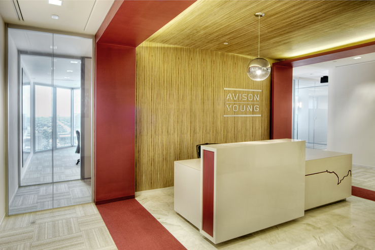 Corporate Interior Design Houston Avison Young Red and Gold Reception Desk
