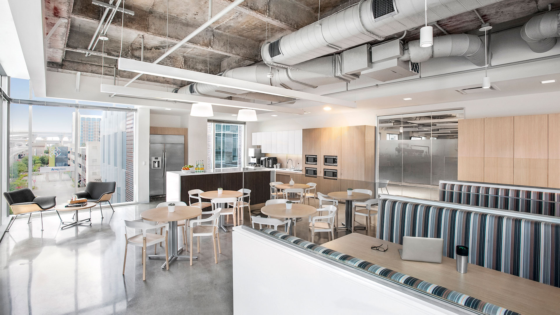 Corporate Interior Design City Center Houston Breakroom Natural Light Exposed Ceiling