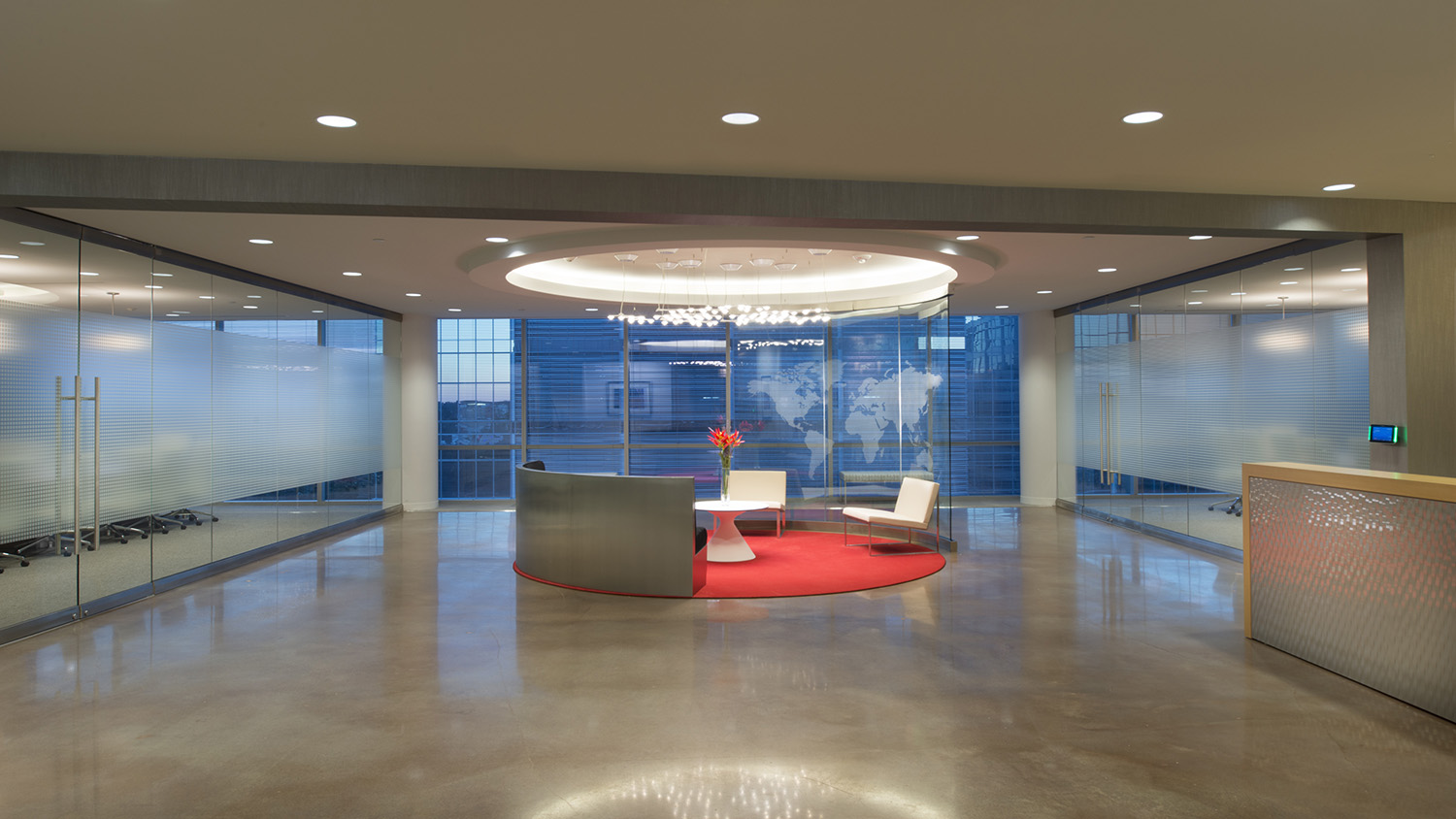 Corporate Interior Design Houston Energy Alloys Entry Lobby Concrete Floors Red Circular Seating Area