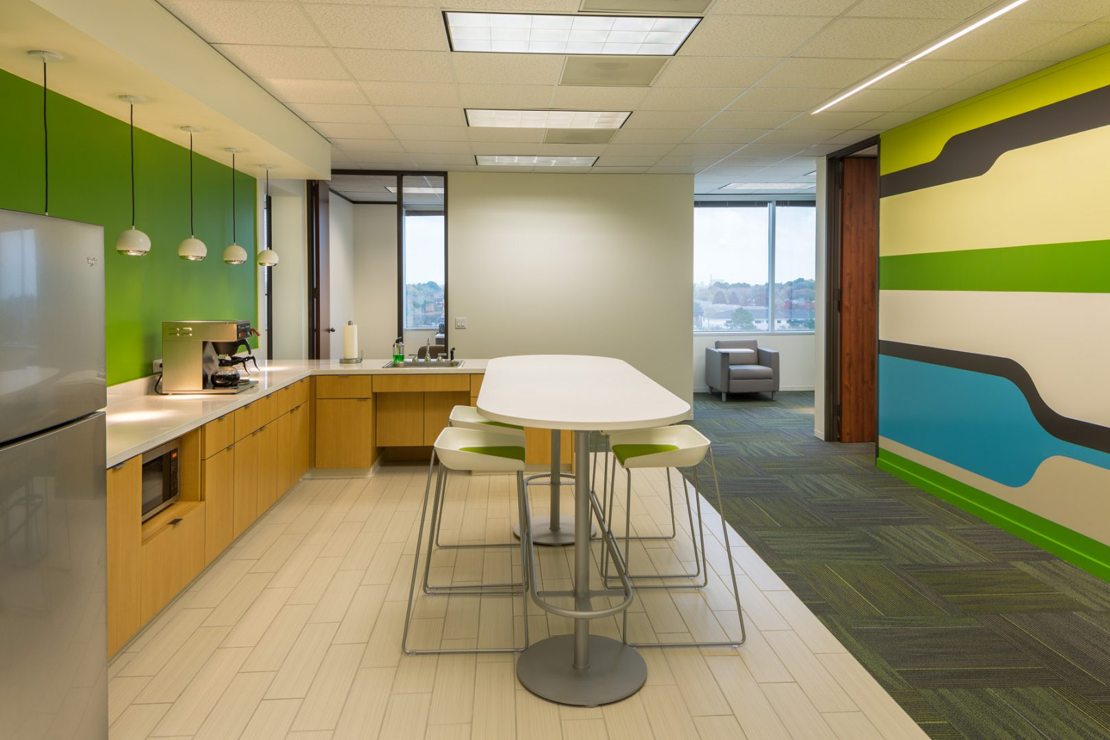 Workplace Interior Design Flow-Cal Houston Coffee Bar Island Colorful Wall Graphics