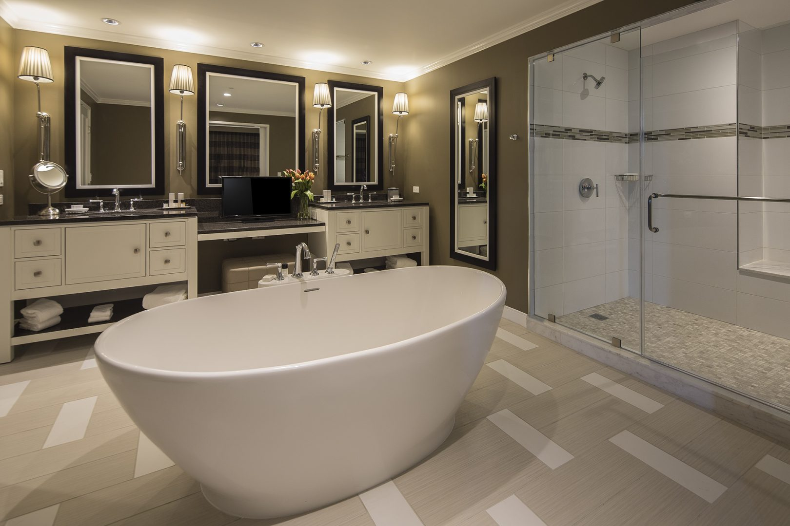 Hospitality Architecture Interior Design Golden Nugget Lake Charles Rush Tower Luxury Bathroom Double Vanity Free Standing Tub Walk in Shower