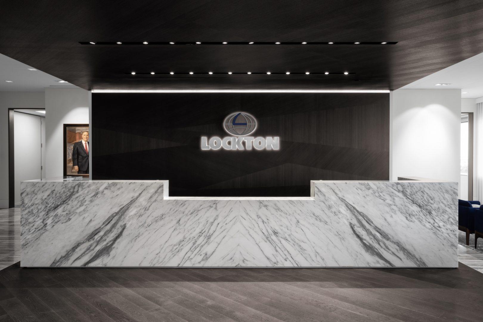 Corporate Interior Design Lockton Houston Reception Desk Bookmatch Quartzite Wood Panelling