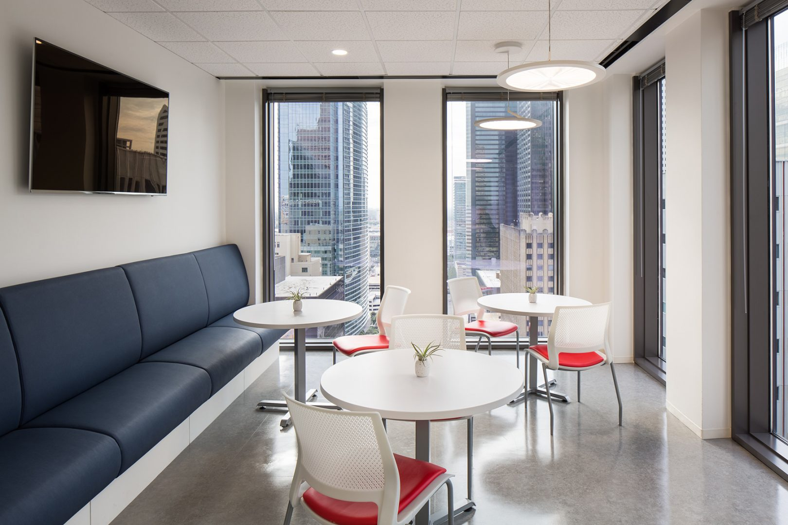 Corporate Interior Law Design McFarland Houston Breakroom Seating Banquette and tables