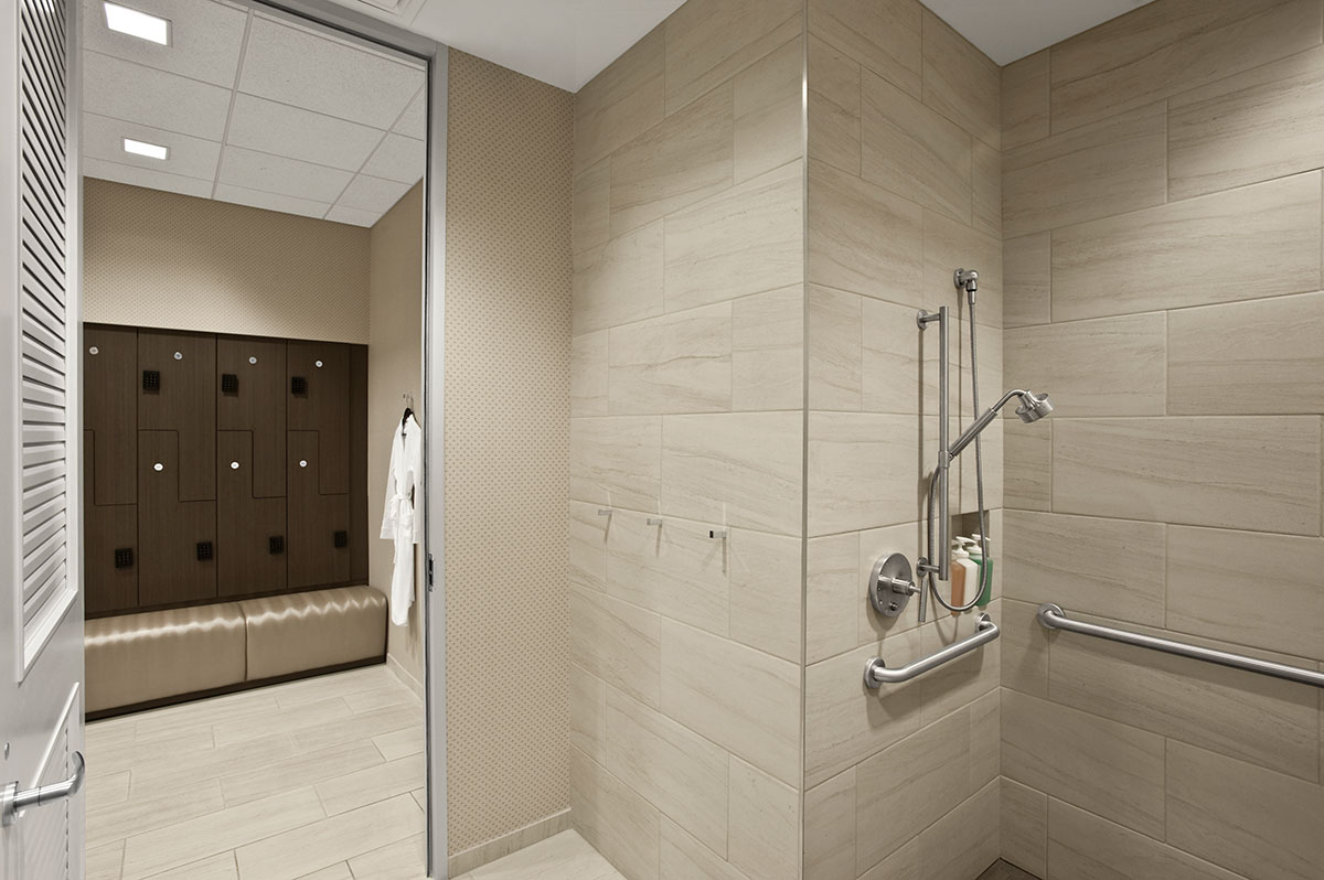 Corporate Interior Design Fitness Center Newfield Fitness Center Locker Room Grab Bars Shower Changing Area