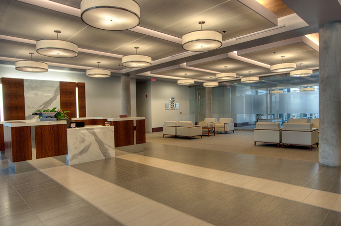 Corporate Interior Design Superior Energy Services Houston Reception Entrance Lobby Seating Ceiling Grid Pendants