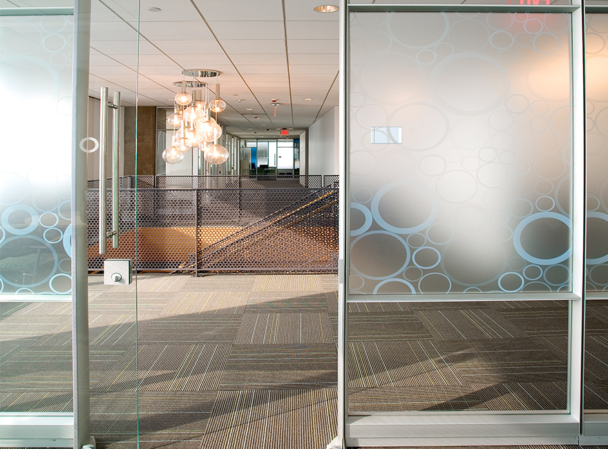 Corporate Interior Design LEED V&M Tubes Houston Pendant Lights above Staircase Glass Front Office