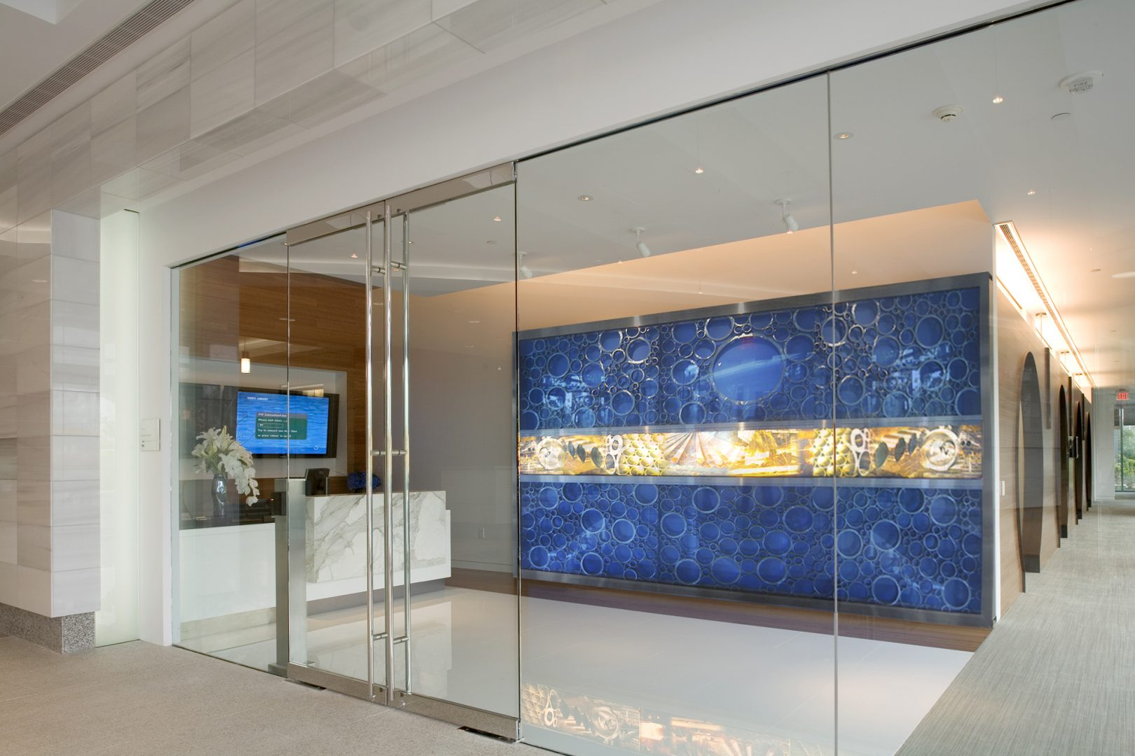 Corporate Interior Design LEED V&M Tubes Houston Reception Lobby Blue Accent Wall